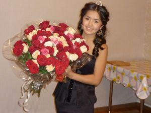 Aika on her 19th birthday, holding roses from a suitor.