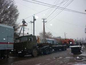 Crews repairing downed electricity lines in Bishkek.