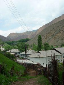 Homes nestled among Ming-Kush's mountains.