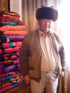 """I spend most of my free time writing genealogy charts of the Kyrgyz tribes. And when there are cases I resolve them."" ""Can I take a picture of you?"" ""Get one of me with my hat!"""