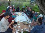 "Members of a Kyrgyz village's government take a joint retreat in the mountains, eating the Kyrgyz national dish ""besh-barmak."""
